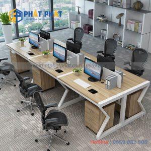 Sự góp mặt của bàn văn phòng có vách ngăn trong không gian làm việc hiện nay